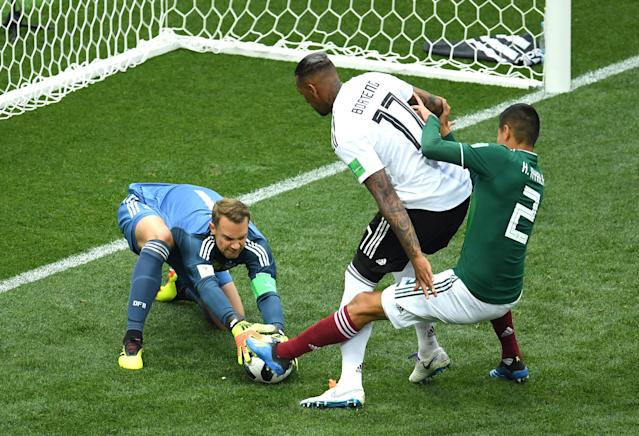 <p>Manuel Neuer of Germany makes a save from Hugo Ayala of Mexico, as Jerome Boateng of Germany protects the ball during the 2018 FIFA World Cup Russia group F match between Germany and Mexico at Luzhniki Stadium on June 17, 2018 in Moscow, Russia. (Photo by Matthias Hangst/Getty Images) </p>