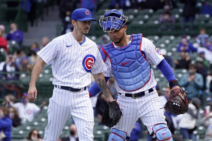 Chicago Cubs catcher Willson Contreras, right, congratulates starting pitcher Zach Davies after Davies got out of a no outs, base-loaded jam during the seventh inning of a baseball game against the Pittsburgh Pirates, Friday, May 7, 2021, in Chicago. (AP Photo/Charles Rex Arbogast)