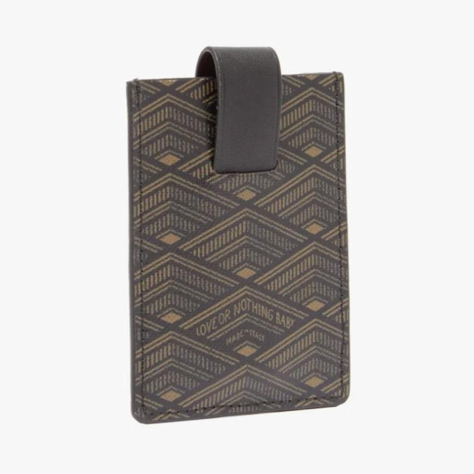 """$225, MATCHESFASHION.COM. <a href=""""https://www.matchesfashion.com/us/products/M%C3%A9tier-Logo-print-coated-canvas-wallet%09-1337850"""" rel=""""nofollow noopener"""" target=""""_blank"""" data-ylk=""""slk:Buy Now"""" class=""""link rapid-noclick-resp"""">Buy Now</a><br>"""