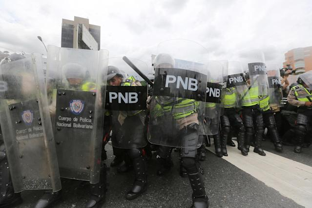 <p>Police fire tear gas and rubber bullets to disperse opposition protesters on Francisco Fajardo Highway in Caracas, June 7, 2016. (AP/Fernando Llano) </p>