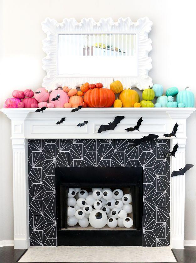 """<p>Change the entire look of your fireplace by applying removable wallpaper. (Note: This works best on smoother surfaces, like a tiled surround.) Then fill the hearth with something equally festive such as eerie plastic eyeballs. </p><p><a class=""""link rapid-noclick-resp"""" href=""""https://www.amazon.com/Wallpaper-Contact-Adhesive-Removable-Stripped/dp/B095MXNZ17/ref=sr_1_43?tag=syn-yahoo-20&ascsubtag=%5Bartid%7C10055.g.421%5Bsrc%7Cyahoo-us"""" rel=""""nofollow noopener"""" target=""""_blank"""" data-ylk=""""slk:SHOP WALLPAPER"""">SHOP WALLPAPER</a></p><p><em><a href=""""https://akailochiclife.com/2017/10/restyle-it-wallpapered-fireplace.html"""" rel=""""nofollow noopener"""" target=""""_blank"""" data-ylk=""""slk:Get the tutorial at A Kailo Chic Life »"""" class=""""link rapid-noclick-resp"""">Get the tutorial at A Kailo Chic Life »</a></em> </p>"""