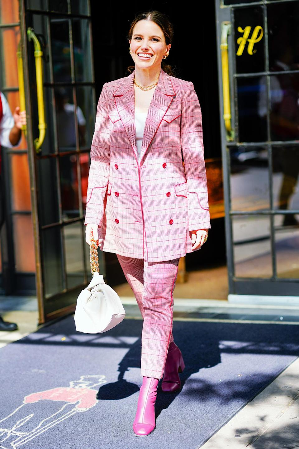 <p>Sophia Bush looks pretty in pink while out in N.Y.C. on June 16.</p>