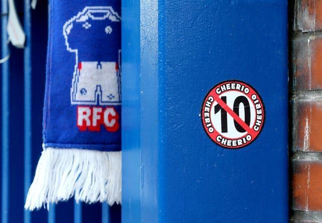A sticker on a gate at Ibrox referencing Celtic's attempt to win 10 Scottish Premiership titles in a row