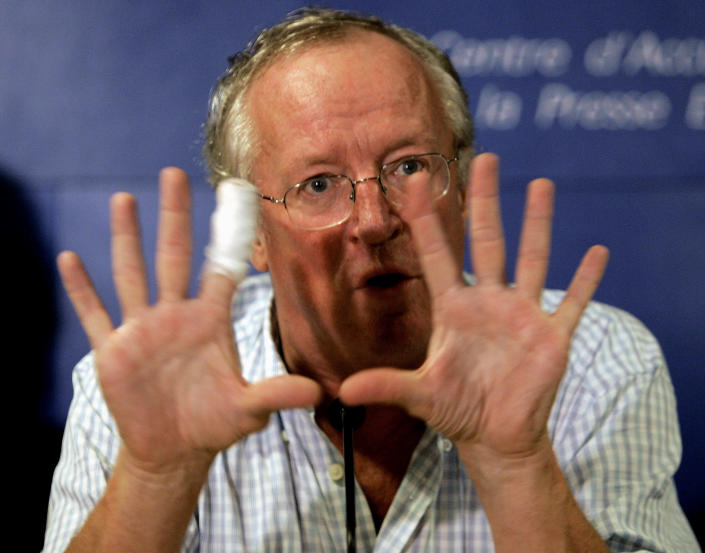 """FILE - In this Oct. 25, 2005 file photo, veteran British Middle East news journalist, Robert Fisk, gestures during a press conference for the launch of the French version of his book """"The Great War for Civilisation: the Conquest of the Middle East,"""" in Paris, France. Fisk, one of the best-known Middle East correspondents who spent his entire career reporting from the troubled region and won accolades for challenging mainstream narratives died Sunday at a hospital in Dublin after a short illness. He was 74. (AP Photo/Francois Mori, File)"""