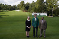 Lee Elder, right, Fred Ridley, Chairman of Augusta National Golf Club, and Sharon Elder posed for a picture on the first tee at the Masters golf tournament Monday, Nov. 9, 2020, in Augusta, Ga. Ridley, announced today that Lee Elder, the first Black man to compete in the Masters Tournament 45 years ago, will be honored by establishing scholarships in his name and inviting him to be an Honorary Starter for the 2021 Masters. (AP Photo/Chris Carlson)