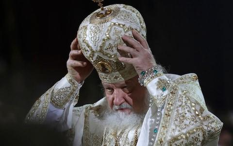 Patriarch Kirill serves the Christmas Mass in the Christ the Savior Cathedral in Moscow, Russia - Credit: AP