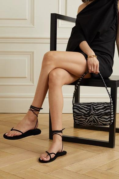 """<p>A delicate lace-up sandal, like these  </p><p><br></p> <p><a href=""""http://www.net-a-porter.com/en-us/shop/product/porte-paire/shoes/flat/suede-sandals/10163292708192957"""" class=""""link rapid-noclick-resp"""" rel=""""nofollow noopener"""" target=""""_blank"""" data-ylk=""""slk:PORTE &amp; PAIRE Black Suede sandals"""">PORTE &amp; PAIRE Black Suede sandals</a> ($210), makes every outfit look fresh for summer. Try pairing with dresses, jorts, or a linen summer short suit.</p>"""