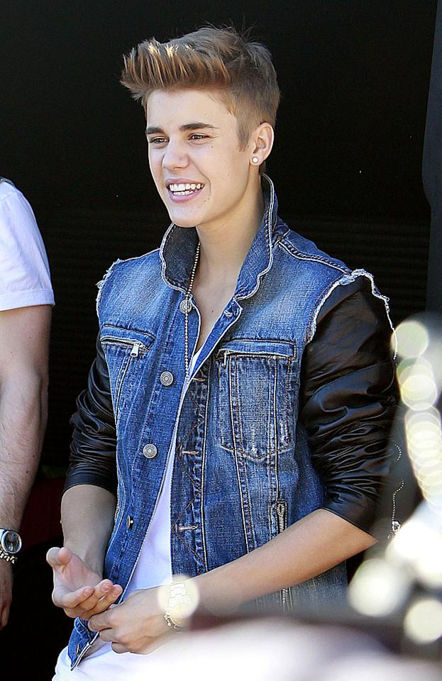 Justin Bieber, 18, can do no wrong in the eyes of his fans, and that includes his fashion choices, which have included faux glasses, a black leather jacket, eye-catching sneakers and now ... a frayed denim vest. Do you like the Biebs' '90s-inspired look? (6/27/2012)