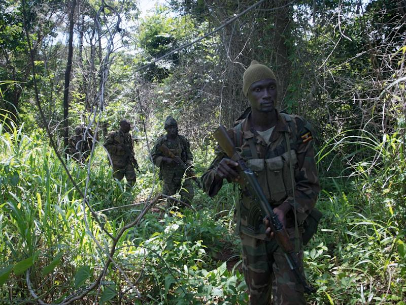 Soldiers from the Uganda People's Defence Force (UPDF) patrol in the Central African Republic looking for Lord's Resistance Army (LRA) fighters on June 24, 2014 (AFP Photo/Michele Sibiloni)