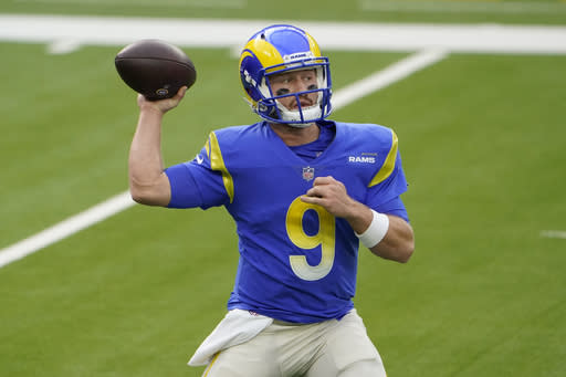 Los Angeles Rams quarterback John Wolford (9) passes against the Arizona Cardinals during the first half of an NFL football game in Inglewood, Calif., Sunday, Jan. 3, 2021. (AP Photo/Jae C. Hong)