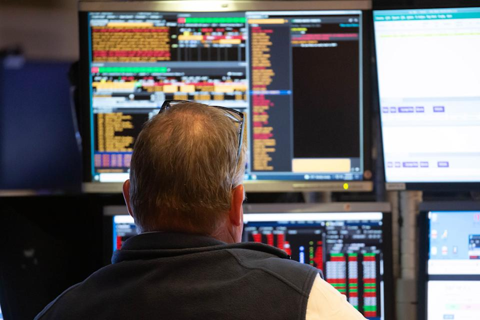 A trader works at the trading floor in the New York Stock Exchange in New York, the United States, Sept. 20, 2021.  U.S. stocks tumbled on Monday as selling pressure intensified on Wall Street.  The Dow Jones Industrial Average fell 614.41 points, or 1.78 percent, to close at 33,970.47, after shedding by more than 970 points at its session low. The S&P 500 dropped 75.26 points, or 1.70 percent, to 4,357.73. The Nasdaq Composite Index slid 330.06 points, or 2.19 percent, to 14,713.90. (Photo by Xinhua via Getty Images)
