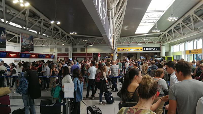 "The scene at Stansted Airport on Saturday morning after Ryanair passengers were left unable to check in ahead of their flights due to a ""systems outage"" which caused delays at airports across Europe. (PA)"