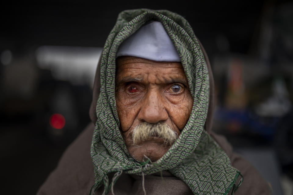 90-year old Mahavir Singh stands for a photograph as he participates in a protest against new farm laws at the Delhi-Uttar Pradesh state border, India, Friday, Jan. 8, 2021. (AP Photo/Altaf Qadri)