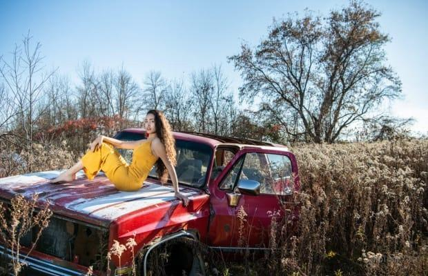 Paul Choquette captured model Savannah Atout and this mid-80s Chevrolet Suburban on a trip to the Boneyard last year. (Submitted/Photomix - image credit)