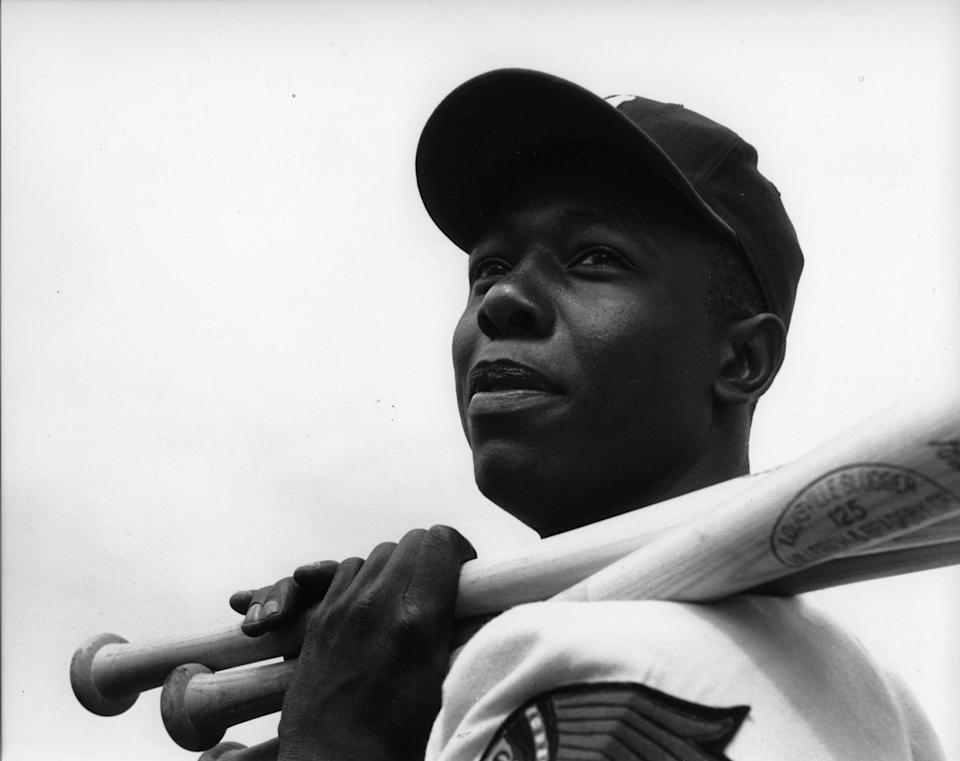 The Milwaukee Braves' Hank Aaron poses for a portraitin 1957. (Photo: Rogers Photo Archive via Getty Images)