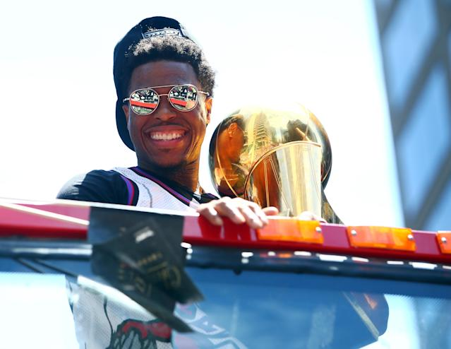 Kyle Lowry #7 of the Toronto Raptors holds the championship trophy during the Toronto Raptors Victory Parade on June 17, 2019 in Toronto, Canada. (Photo by Vaughn Ridley/Getty Images)