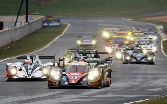 Neel Jani (12), of Switzerland, drives the Rebellion Racing Lola B12/60 Toyota at the start of the American Le Mans Series' Petit Le Mans auto race at Road Atlanta, Saturday, Oct. 19, 2013, in Braselton, Ga. (AP Photo/Rainier Ehrhardt)