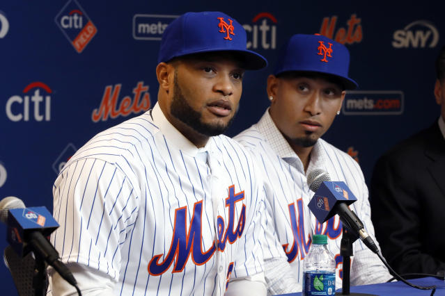 FILE - In this Dec. 4, 2018, file photo, Robinson Cano, left, and Edwin Diaz participate in a news conference at CitiField, in New York. In a flurry of offseason moves that began with a blockbuster trade with Seattle, the Mets added second baseman Cano, closer Diaz, catcher Wilson Ramos and infielder Jed Lowrie. (AP Photo/Richard Drew, File)