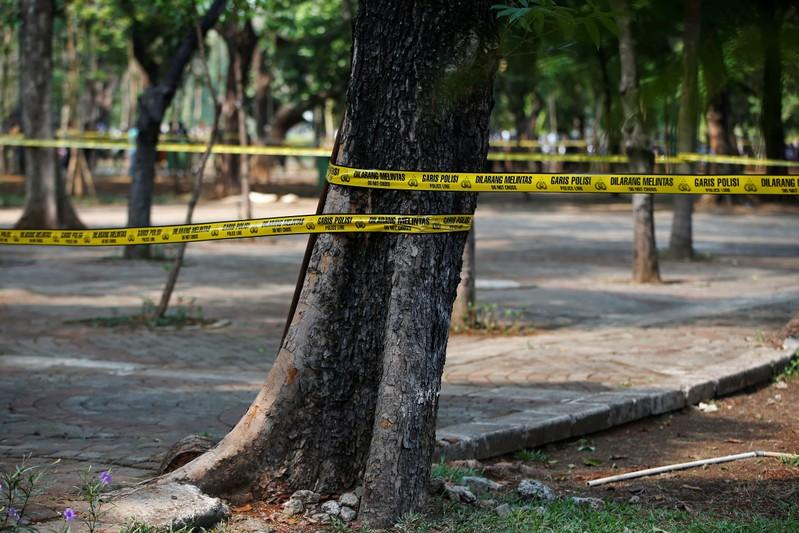 Police tape cordon off an area following a blast at National Monument (Monas) complex in Jakarta