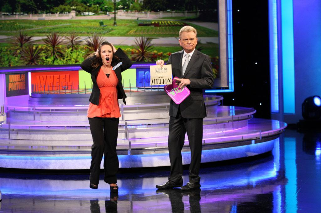 """Wheel of Fortune"" host Pat Sajak opens the bonus round envelope to reveal contestant Autumn Erhard's $1 Million Grand Prize."