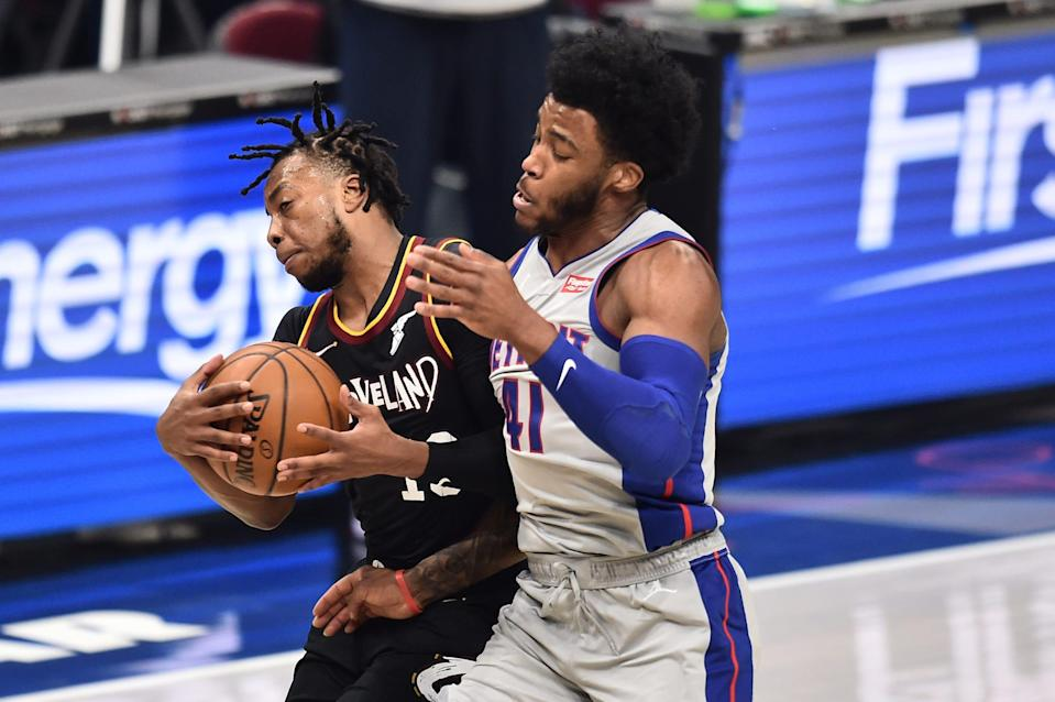 Cleveland Cavaliers guard Darius Garland (10) collides with Detroit Pistons forward Saddiq Bey (41) during the first quarter Jan, 27, 2021, at Rocket Mortgage FieldHouse in Cleveland.