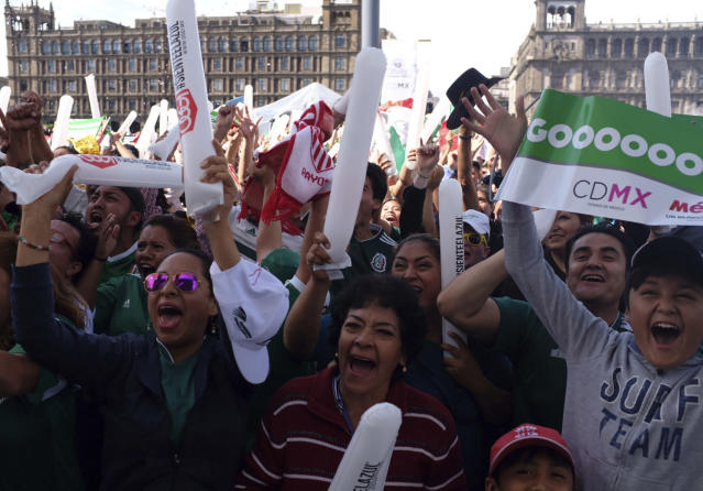 Mexico fans celebrate their team's goal against Germany during soccer World Cup match, in Mexico City's Zocalo, Sunday, June 17. Mexico won it's first match against Germany 1-0. (AP Photo/Anthony Vazquez)