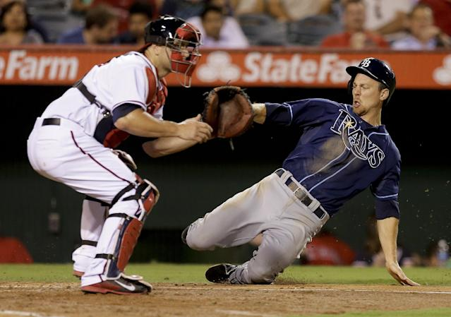 Tampa Bay Rays' Ben Zobrist, right, scores past Los Angeles Angels catcher Chris Iannetta on a ball hit by James Loney during the third inning of a baseball game in Anaheim, Calif., Thursday, Sept. 5, 2013. (AP Photo/Chris Carlson)