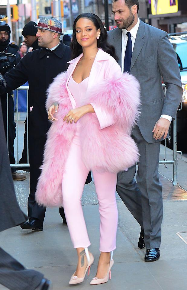 <p>RiRi arriving for a Good Morning America appearance in a pink stole to match her pink suit (and pink Loubou's).<br /></p><p><br /></p>