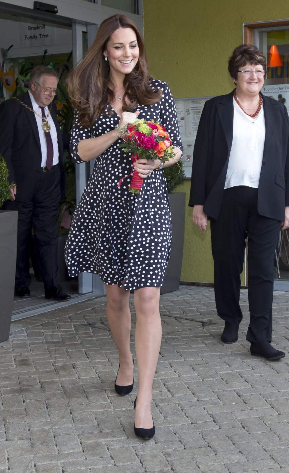 <p>Kate opted for a polka dot ASOS Maternity dress and her favourite black Mulberry clutch for a children's charity visit. The Duchess's shoes were by Stuart Weitzman. </p><p><i>[Photo: PA]</i></p>