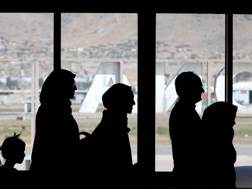 People wait to board a flight permitted to leave Kabul airport on 13 September (Karim Sahib/AFP via Getty Images)