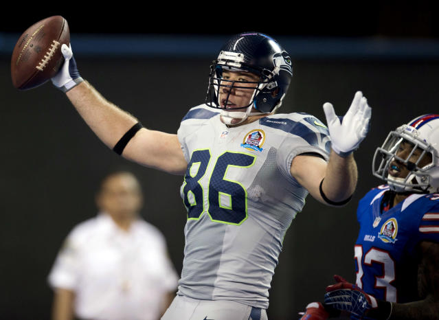 Seattle Seahawks tight end Zach Miller (86) celebrates his touchdown reception ahead of Buffalo Bills defensive back Ron Brooks during the first half of an NFL football game, Sunday, Dec. 16, 2012, in Toronto. (AP Photo/The Canadian Press, Frank Gunn)