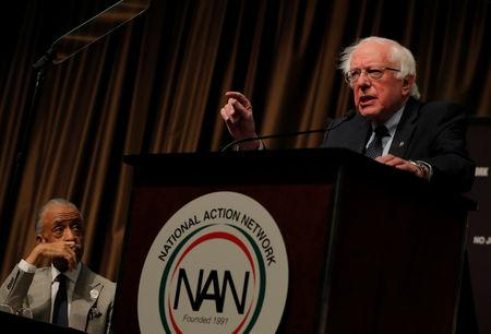 U.S. 2020 Democratic presidential candidate and U.S. Senator Bernie Sanders (I-VT), speaks as Rev. Al Sharpton looks on at the 2019 National Action Network National Convention in New York, U.S., April 5, 2019.  REUTERS/Lucas Jackson