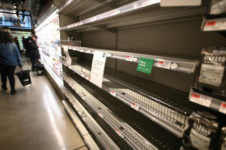 Customers are scrambling to stock up on supplies, leaving empty shelves in many grocery stores, such as this organic supermarket in Manhattan on March 13