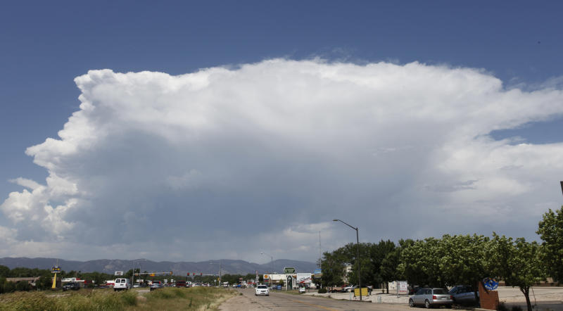A thunderhead builds over the High Park wildfire and Fort Collins, Colo., on Friday, June 15, 2012. Rain could assist in fighting the wildfire that started Saturday and has burned over 50,000 acres. (AP Photo/Ed Andrieski)