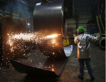 FILE PHOTO: A worker cuts a steel coil at the Novolipetsk Steel PAO steel mill in Farrell, Pennsylvania