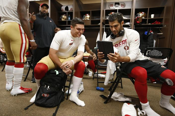 LANDOVER, MD - OCTOBER 20: Nick Mullens #4 and Jimmy Garoppolo #10 of the San Francisco 49ers relax in the locker room prior to the game against the Washington Redskins at FedExField on October 20, 2019 in Landover, Maryland. The 49ers defeated the Redskins 9-0. (Photo by Michael Zagaris/San Francisco 49ers/Getty Images)