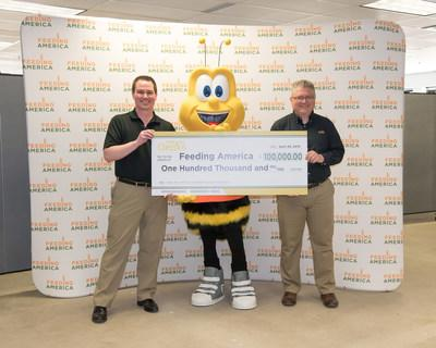 Honey Nut Cheerios™ surprises Feeding America at a member food pantry in Minneapolis, Second Harvest Heartland, with $100,000 check in celebration of the organization's first place finish in the national Honey Nut Cheerios Good Rewards program