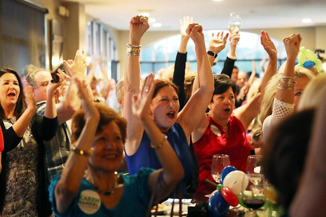 <p>People listen as Republican candidate Karen Handel speaks during a campaign stop at Houck's Grille as she runs for Georgia's 6th Congressional District on June 19, 2017 in Roswell, Ga. (Photo: Joe Raedle/Getty Images) </p>