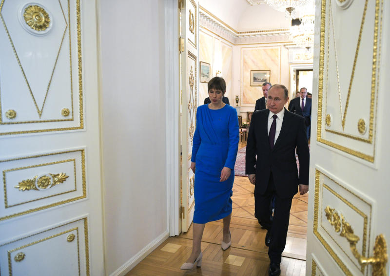 Russian President Vladimir Putin, right, and Estonia's President Kersti Kaljulaid walk inside the Kremlin in Moscow, Russia, Thursday, April 18, 2019.Thursday's meeting between the presidents of Russia and Estonia is the first one for the leaders of the two neighboring countries in nearly a decade. (Alexei Druzhinin, Sputnik, Kremlin Pool Photo via AP)