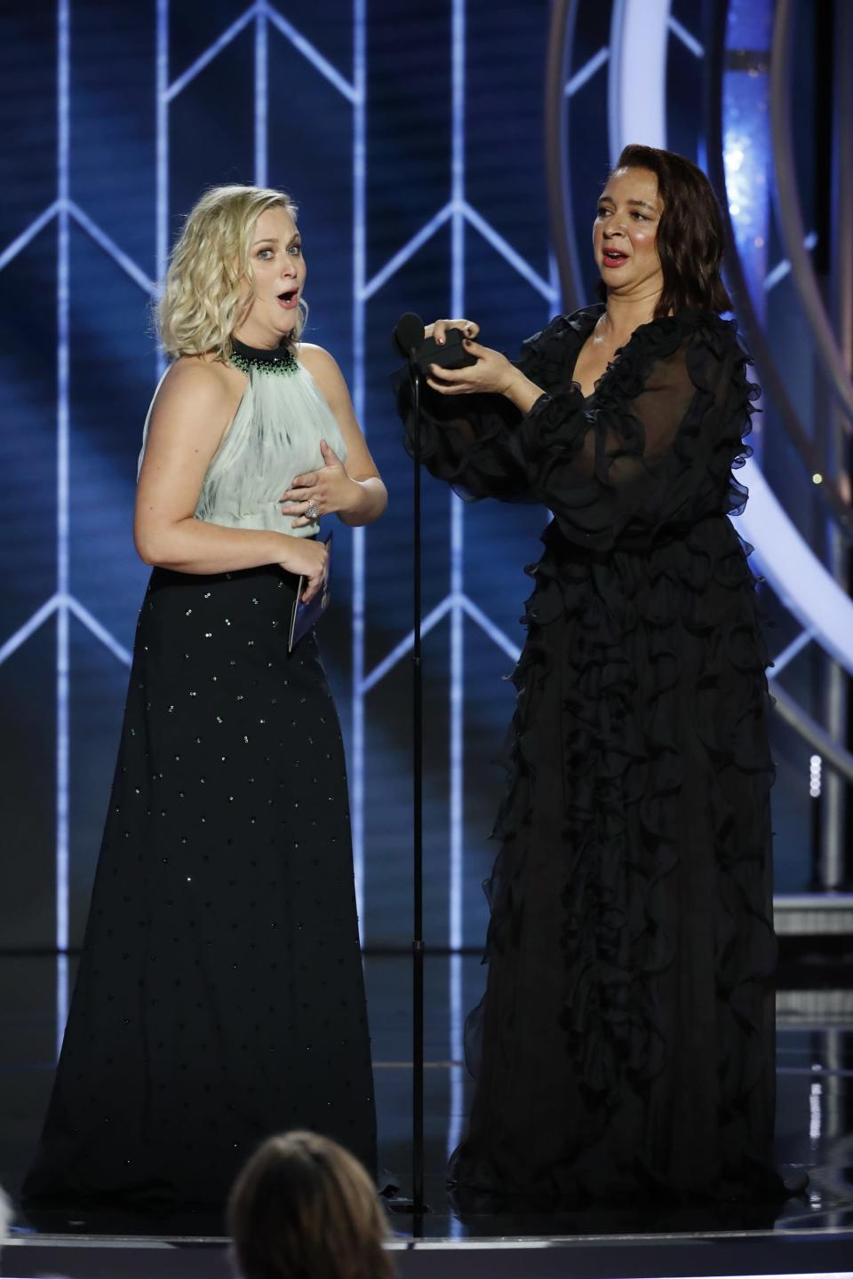 Maya Rudolph pops the question to Amy Poehler at the Golden Globes. (Photo: Paul Drinkwater/NBC Universal/Handout via Reuters)