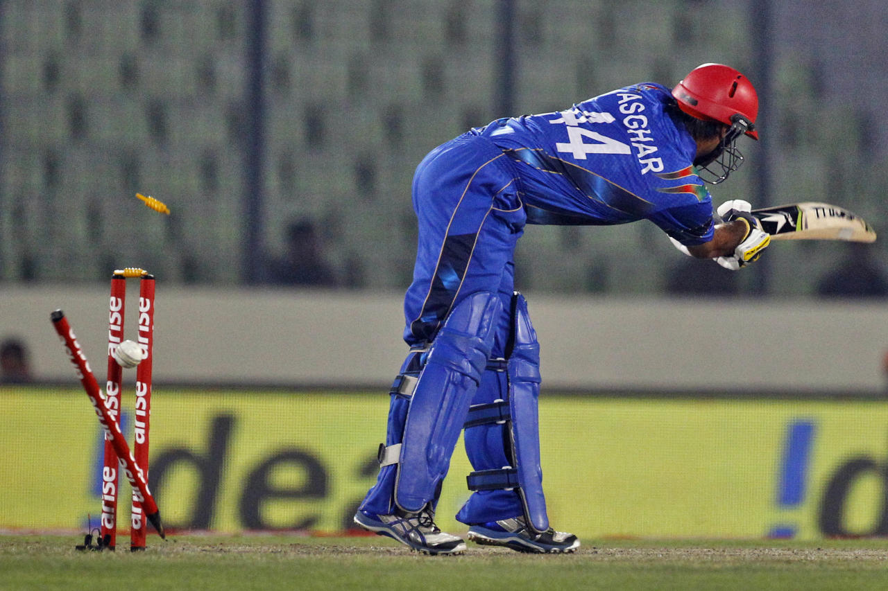 Afghanistan's Asghar Stanikzai is bowled out by Sri Lanka's Thisara Perera during the Asia Cup one-day international cricket tournament between them in Dhaka, Bangladesh, Monday, March 3, 2014. (AP Photo/A.M. Ahad)
