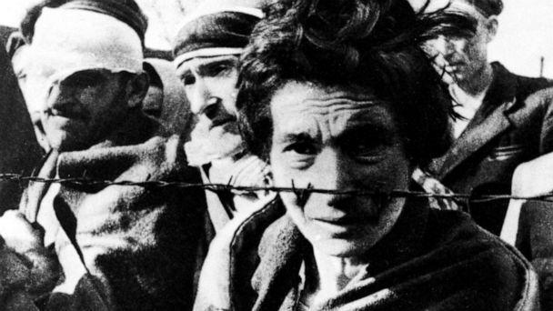 PHOTO: A few of the survivors of Auschwitz stand near a fence during the arrival of the Soviet Army on Jan. 27, 1945. (Galerie Bilderwelt/Getty Images)