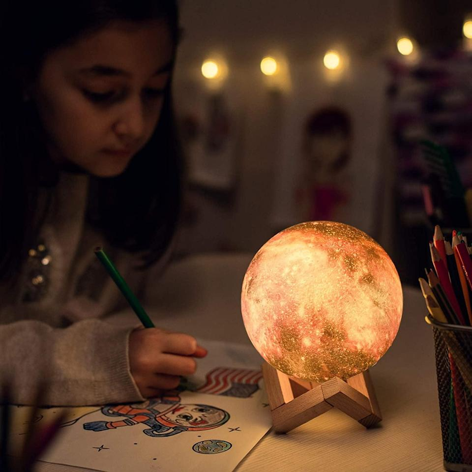 <p>If they love space, we have a feeling they'll be into the <span>3D Galaxy Moon Lamp</span> ($20).</p>