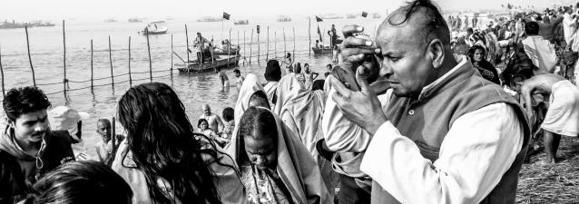 ALLAHABAD, INDIA - JANUARY 13: (EDITORS NOTE: Image was created using the iPhone panoramic application) Hindu devotees dress themselves after having bathed on the banks of Sangam on January 13, 2013 in Allahabad, India. The Maha Kumbh Mela, believed to be the largest religious gathering on earth is held every 12 years on the banks of Sangam, the confluence of the holy rivers Ganga, Yamuna and the mythical Saraswati. The Kumbh Mela alternates between the cities of Nasik, Allahabad, Ujjain and Haridwar every three years. The Maha Kumbh Mela celebrated at the holy site of Sangam in Allahabad, is the largest and holiest, celebrated over 55 days, it is expected to attract over 100 million people. (Photo by Daniel Berehulak/Getty Images)