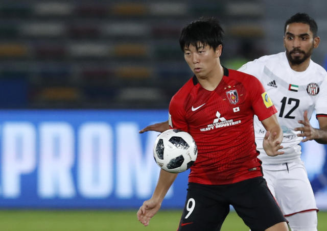 Japan's Urawa Reds Yuki Muto, left, challenges for the ball with Al Jazira's Salim Rashid during the Club World Cup soccer match between Al Jazira Club and Urawa Reds at Zayed sport city in Abu Dhabi, United Arab Emirates, Saturday, Dec. 9, 2017. (AP Photo/Hassan Ammar)