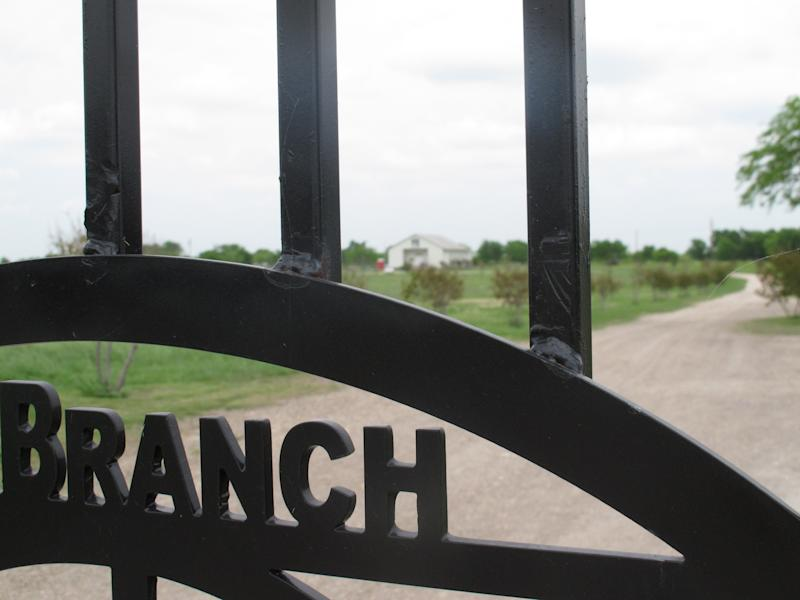 A chapel built on the site of the Branch Davidian compound that burned down in 1993 after a standoff stemming from botched federal raid can be seen through a gate on Wednesday, April 17, 2113, about 10 miles outside Waco, Texas. Some survivors held a memorial service marking the 20th anniversary of the fiery end of the standoff Friday, April 19, 2013, at a Waco museum. (AP Photo/Angela K. Brown)