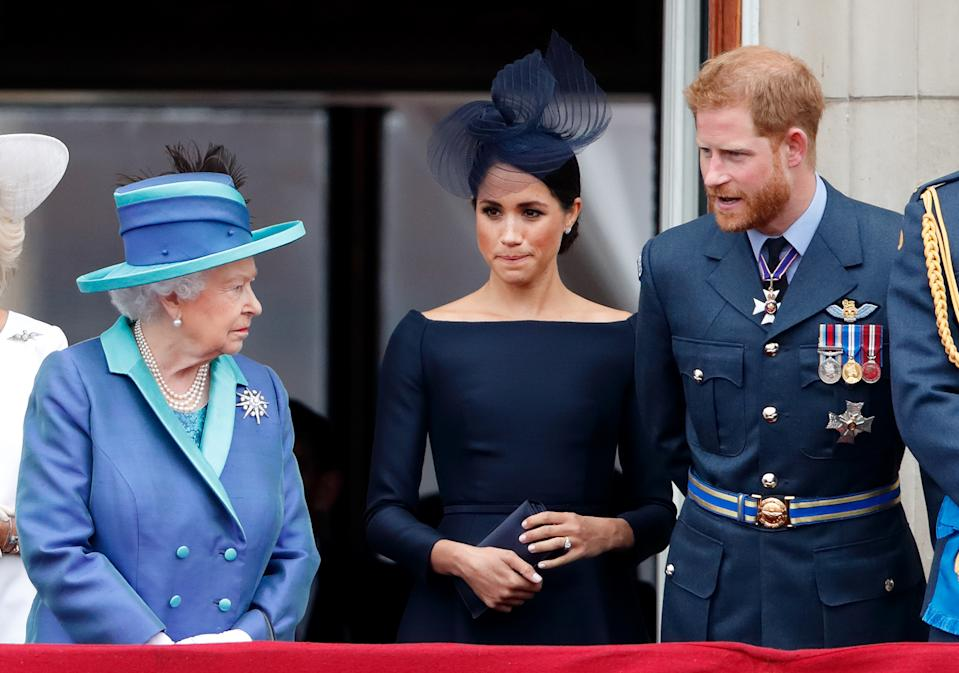 Prince Harry and Meghan Markle look incredulous as Queen Elizabeth looks at then sternly at Trooping the Colour