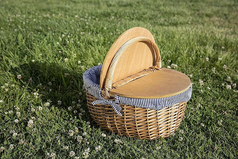 <p>This <span>Picnic Time Country Picnic Basket</span> ($49) will help you live your best cottagecore life.</p>