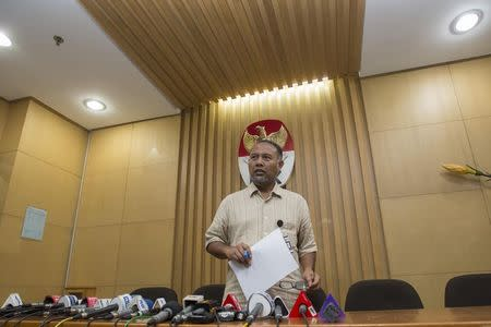 Bambang Widjojanto, deputy chief of the the Corruption Eradication Commission (KPK), is seen addressing the media in Jakarta, January 14, 2015 in this photograph taken by Antara Foto. REUTERS/Antara Foto/Rosa Panggabean