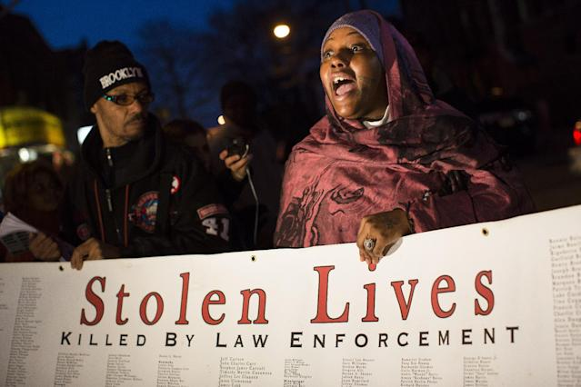 "Demonstrator Fatimah Shakur speaks during a vigil held for Kimani ""Kiki"" Gray in the East Flatbush neighborhood of Brooklyn, Wednesday, March 13, 2013, in New York. The 16-year-old was shot to death on a Brooklyn street last Saturday night by plainclothes police officers who claim the youth pointed a .38-caliber revolver at them. (AP Photo/John Minchillo)"